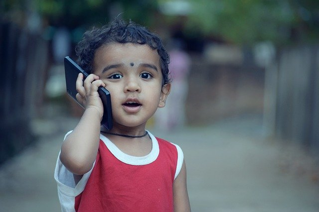 Why is it dangerous for children to use cell phones?